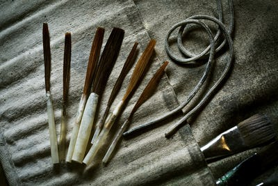 A collection of brushes and hand tools.