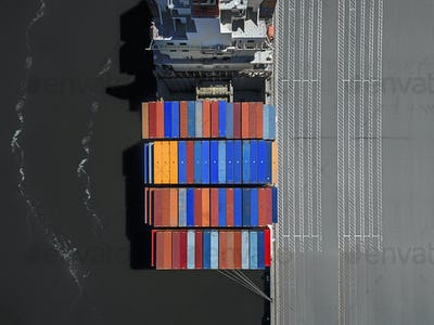 The Port of Oakland, in California. A container ship at the dockside, viewed from above.