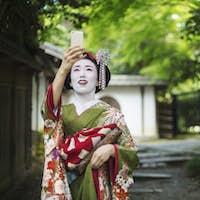 A geisha taking a selfie