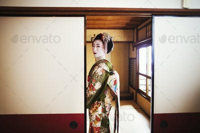 A woman dressed in the traditional geisha style.