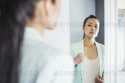 A business woman preparing for work, waking up and dressing.