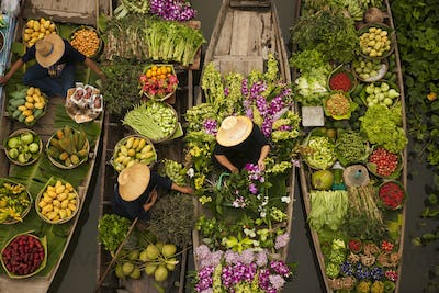 Aerial view of a floating market on a canal in Bangkok