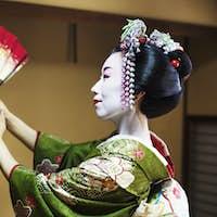 A woman in geisha costume