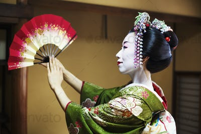 A woman in geisha costume