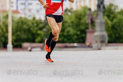 man runner in black compression socks