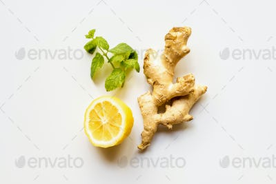 Top View of Ginger Root, Lemon And Mint on White Background