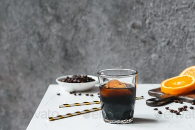 Cold Brew Coffee With Ice in Glass Near Orange Slices on Chopping Board,drinking Straws,coffee Beans