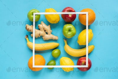 Top View of Ripe Whole Fruits And Square Frame on Blue Background