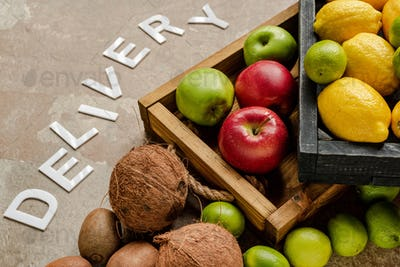 Ripe Fresh Fruits in Wooden Boxes Near Word Delivery on Weathered Surface