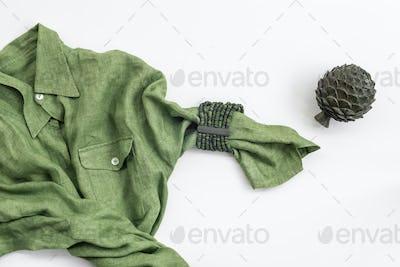Green shirt and metal artichoke