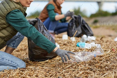 Volunteers cleaning the ground