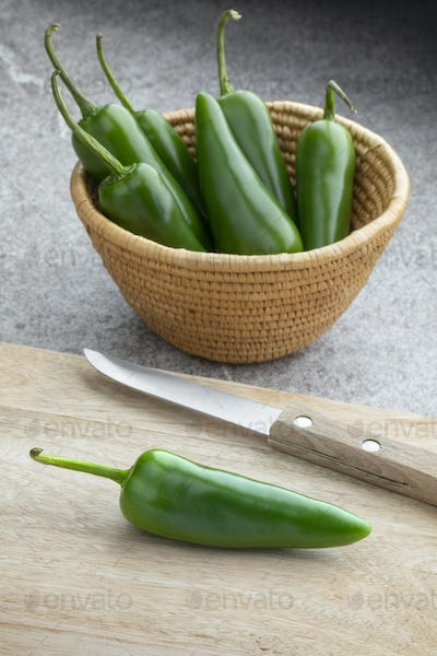 Basket with fresh green jalapeno peppers