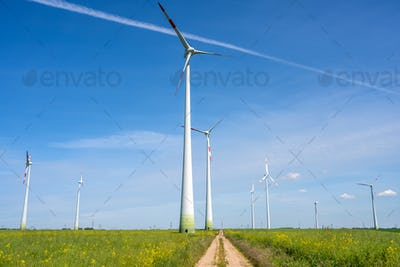 Modern wind turbines and a country road