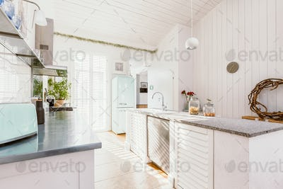 Bright wooden rustic kitchen with white furniture, big window and fridge