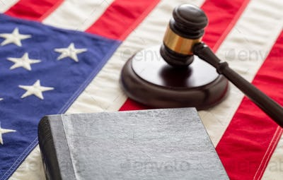 Law gavel and book on United States of America flag.