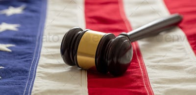 Justice in USA. Law gavel on United States of America flag.