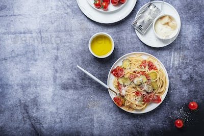 Traditional Italian pasta with tomato, zucchini and parmesan