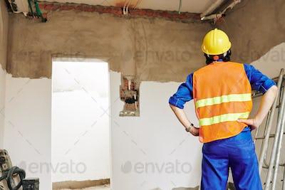 Builder evaluating scope of work