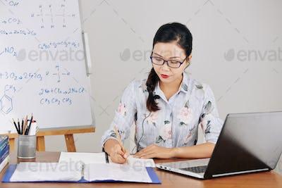Teacher making plan on online lesson