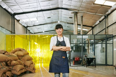 Roastery worker standing in warehouse