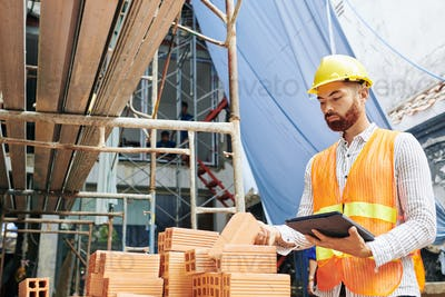 Contractor checking bricks