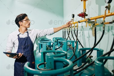 Roastery worker checking pressure