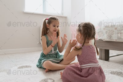 carefree cute girls playing lovely at home
