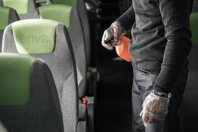 Sanitizing Procedure Inside Of Intercity Coach Bus.