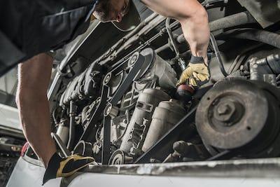 Auto Mechanic Repairing Bus Engine.