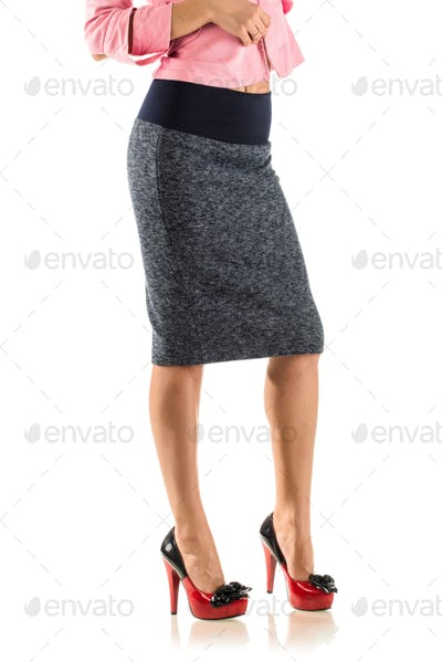 Beautiful young unidentified woman in skirt