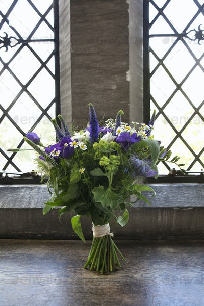 A bouquet of blue and white wedding flowers.