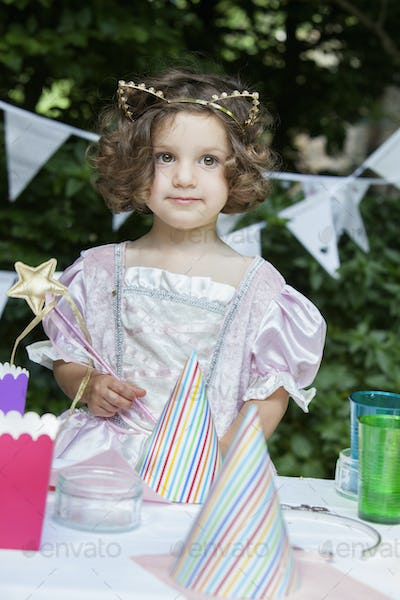 Young girl dressed as a fairy at a garden party.