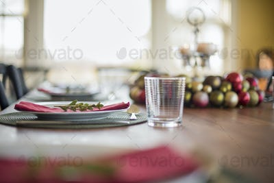 A table laid for a celebration meal with Christmas ornaments.