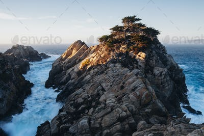 Dramatic cliffs and coastline at dusk in the Point Lobos State Reserve on the Pacific coastline.