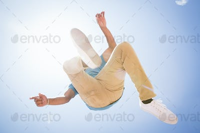 Low angle view of a young man jumping in the air.