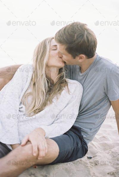 A couple kissing on a beach