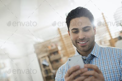 A man checking his smart phone.