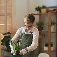 Modern Young Woman Enjoying House Gardening