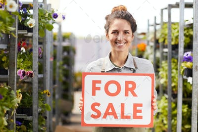 Smiling Woman Holding For Sale Sign at Plantation
