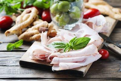 Italian antipasto with chicken ham and bread