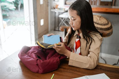asian girl scout student preparing before going to school