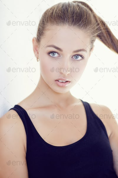Portrait of young sensual girl in dark t shirt.