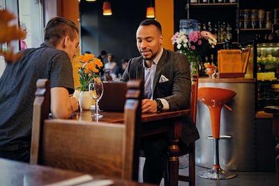 Men having a business meeting in a restaurant.
