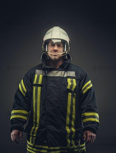 Portrait of male in firefighter costume.