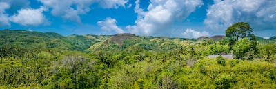 Hills covered by Jungle with Small Templein Front, Nusa Penida Island, Bali, Indonesia