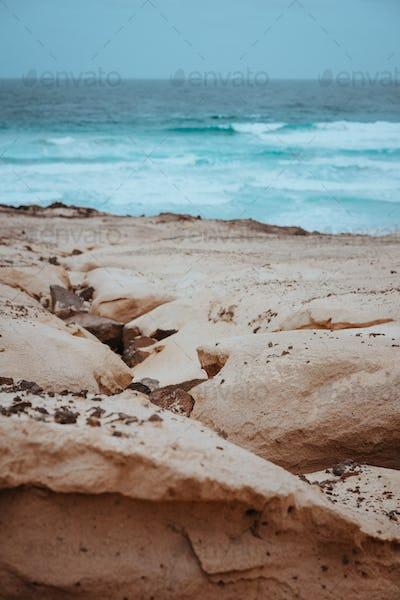 Surreal sand dunes on the Atlantic coastline on Baia Das Gatas. North of Calhau, Sao Vicente Island