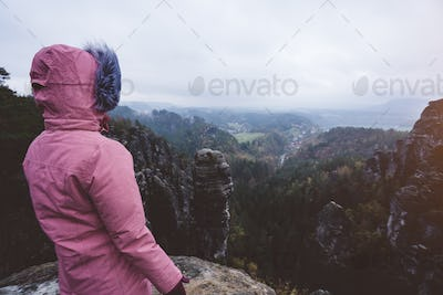 Hiker in outdoor adventure hike trail trip on the top of a mountain, enjoying view of ridge in the