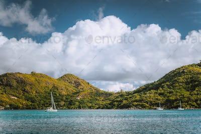 Yacht boats near an uninhabitable island near Victoria city, Mahe, Seychelles