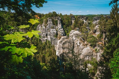 Saxony, Germany. View of famous Bastei rock formation. Elbe Sandstone Mountains. Jutted out rock