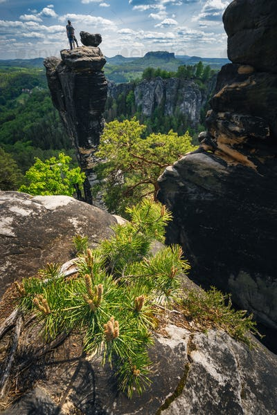 Unrecognized silhouette climber on mountain top in famous Bastei rock formation of national park